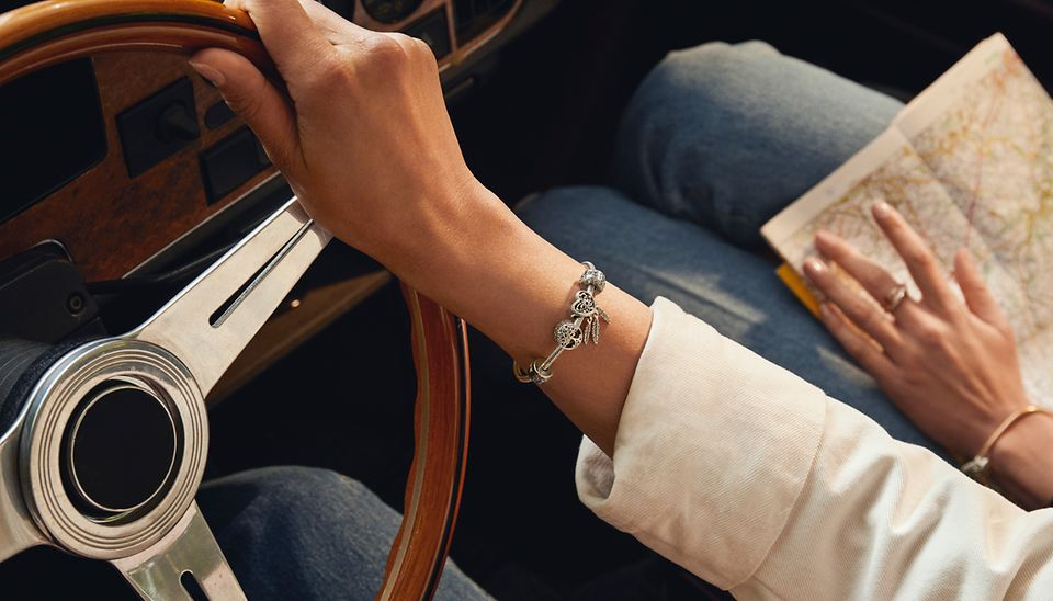 Pandora Moments bracelet styled with travel inspired charms