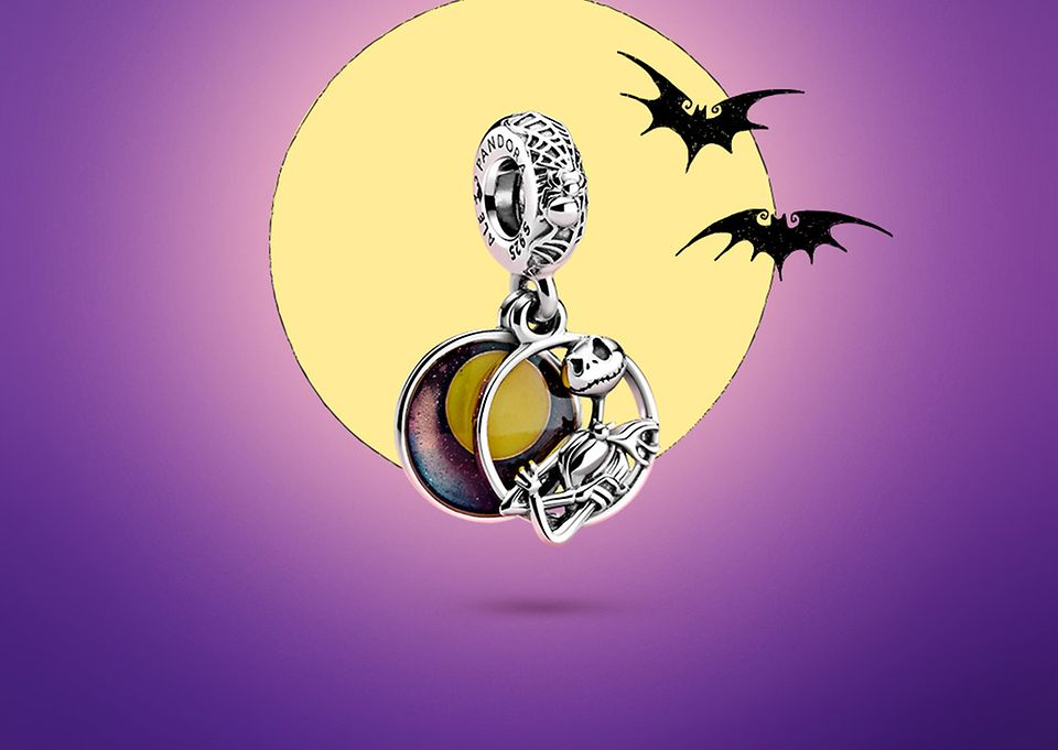 Jack the Pumpkin King set infront of a full moon with two bats flying above.