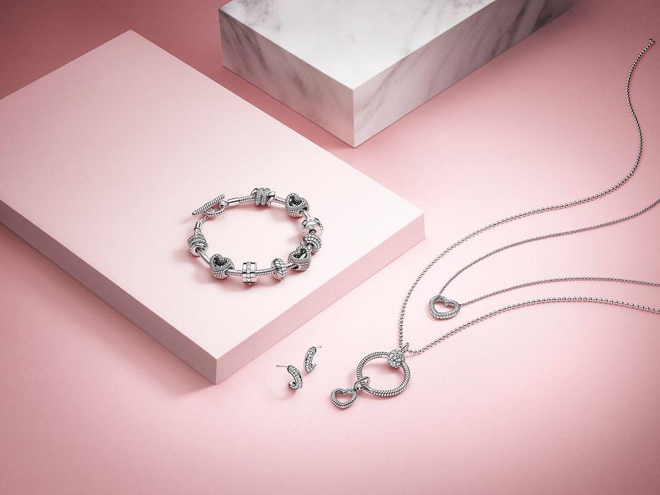 Snake chain pattern bracelet, earrings, charms and Pandora O Pendant