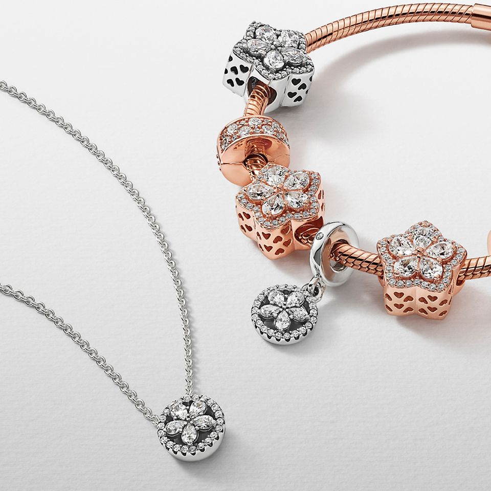 Pandora Timeless charms on a bracelet and matching snowflake pendant.