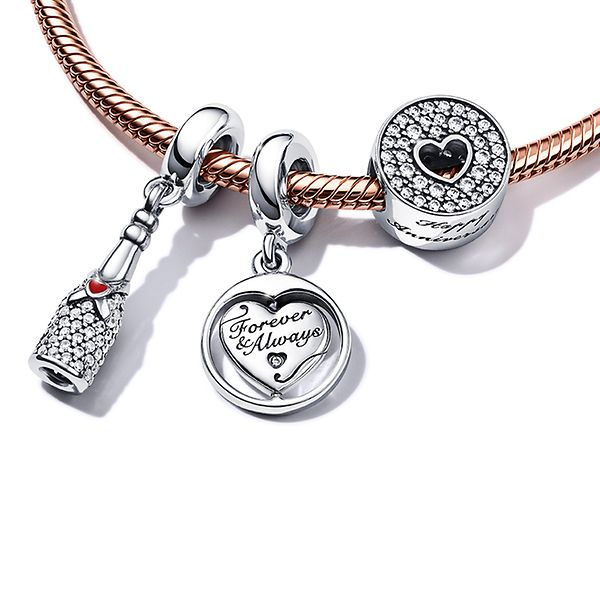 Pandora bracelet decorated with anniversary themed charms and dangles.