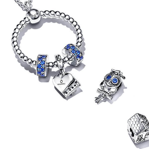 Beaded Pandora O Pendant with achievement themed charms.