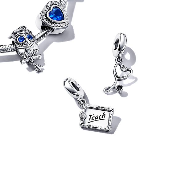 Pandora bracelet with blue and silver graduation themed charms.