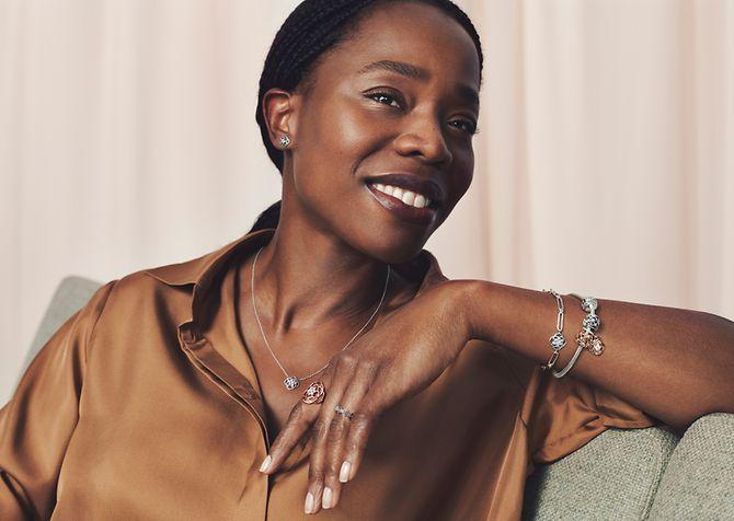Model wearing Pandora Timeless rings, necklace and bracelet.