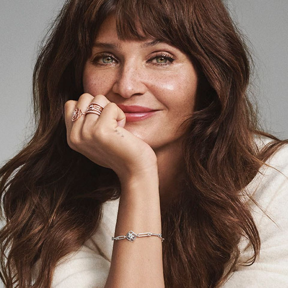 Helena Christensen sat wearing Pandora bracelets and rings.