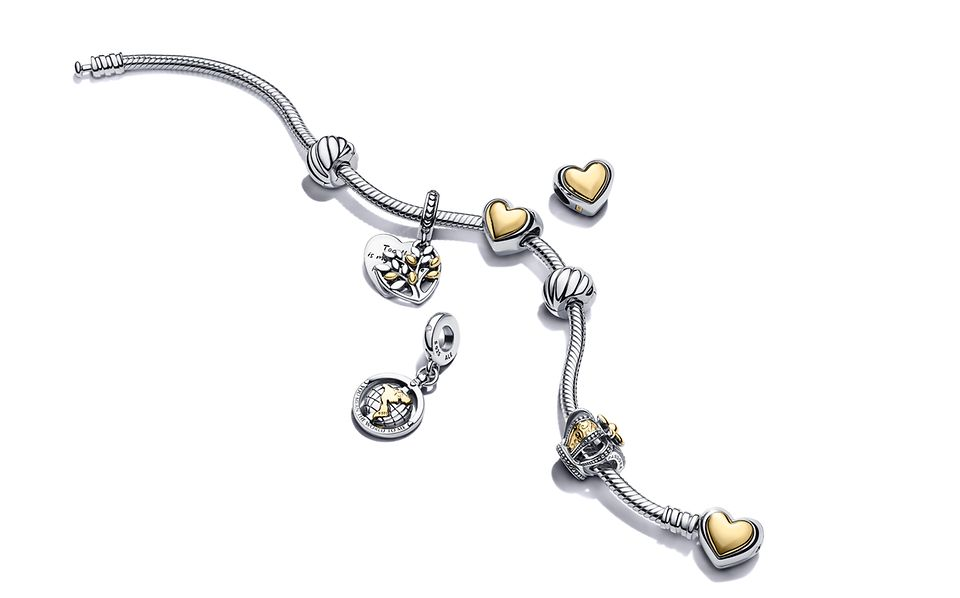 Pandora Moments Two tone snake chain bracelet with Two tone charms and dangles.