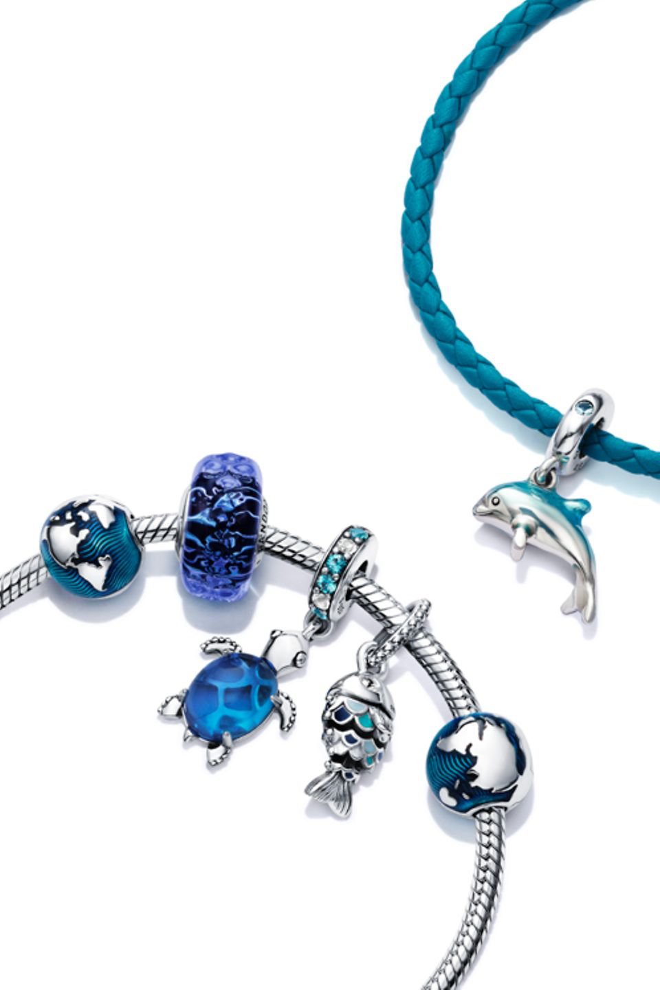 Pandora Blue Ocean sterling silver and blue charms and charm bracelets.