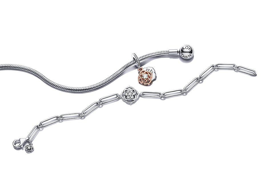 Pandora Timeless snake chain and chain link bracelets featuring floral charms.