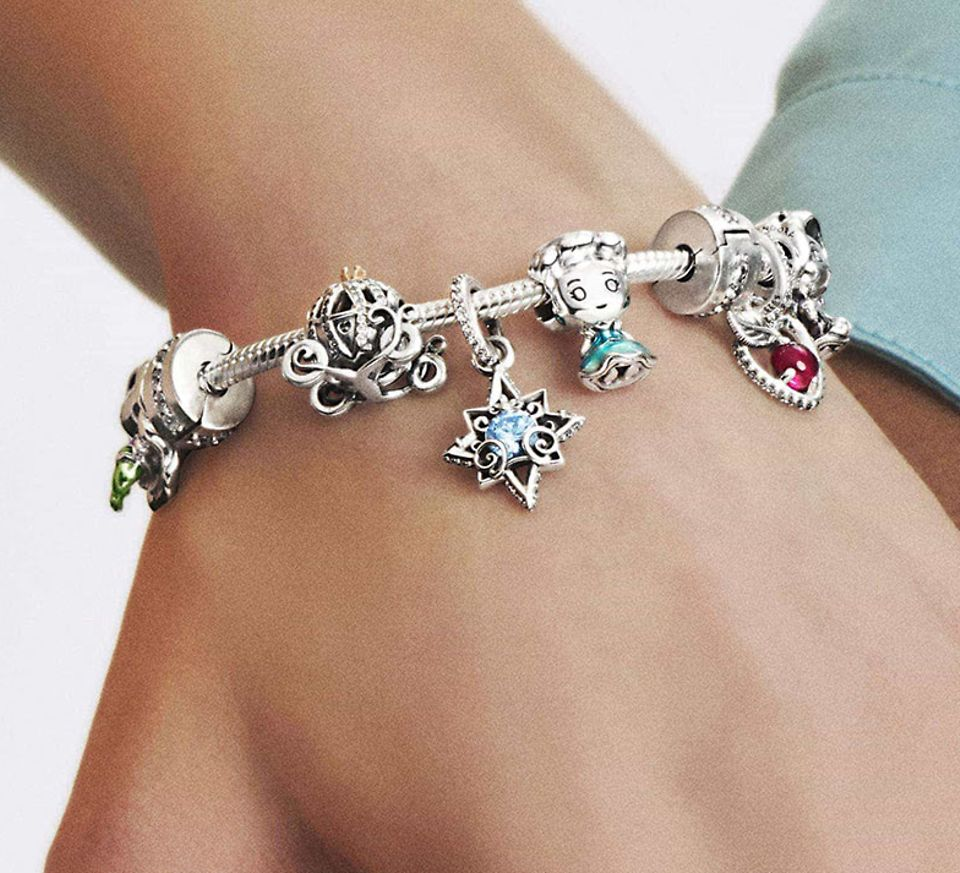Two models wearing colourful charm bracelets from Disney x Pandora