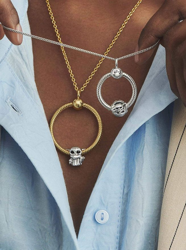 Woman wearing Pandora O Pendant necklaces with charms from Star Wars x Pandora