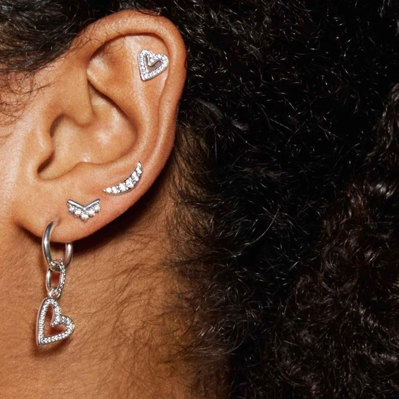 Mix and match ear studs, hoops and ear jackets in sterling silver, Pandora Rose and Pandora Shine and create your own earring stacking look with meaningful pieces.