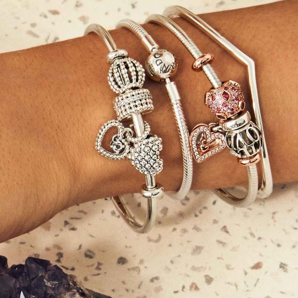 Show your personality through your styling by stacking bracelets and bangles with and without charms to create a look that's uniquely you.