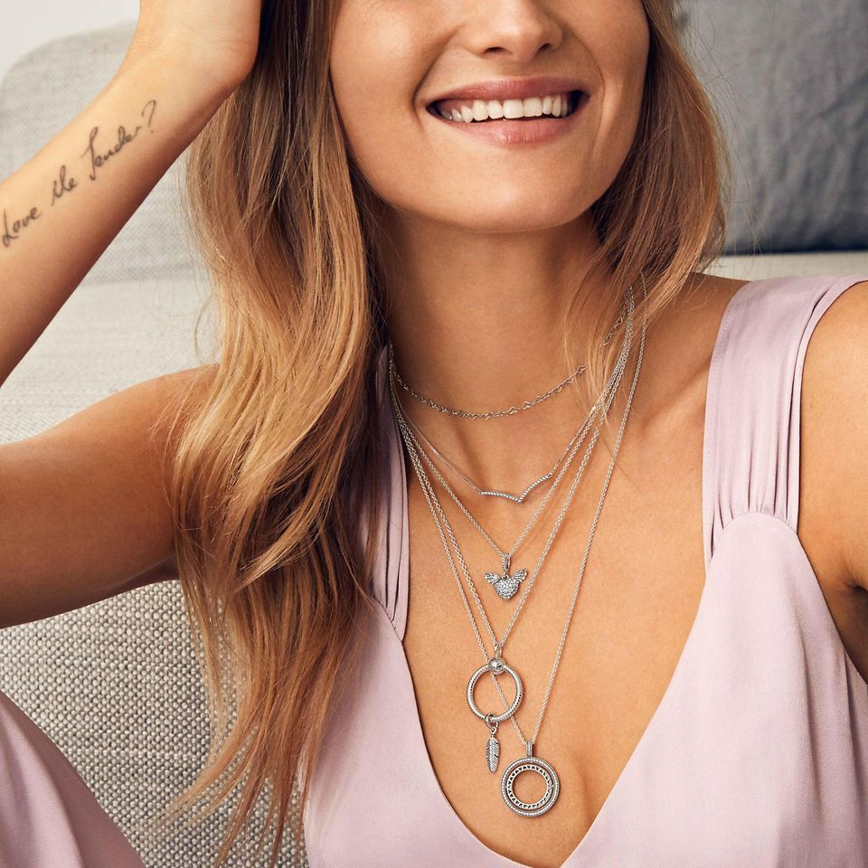 Create a personalised look by layering necklaces in sterling silver, Pandora Rose and Pandora Shine and add charms and dangles to tell your style story.