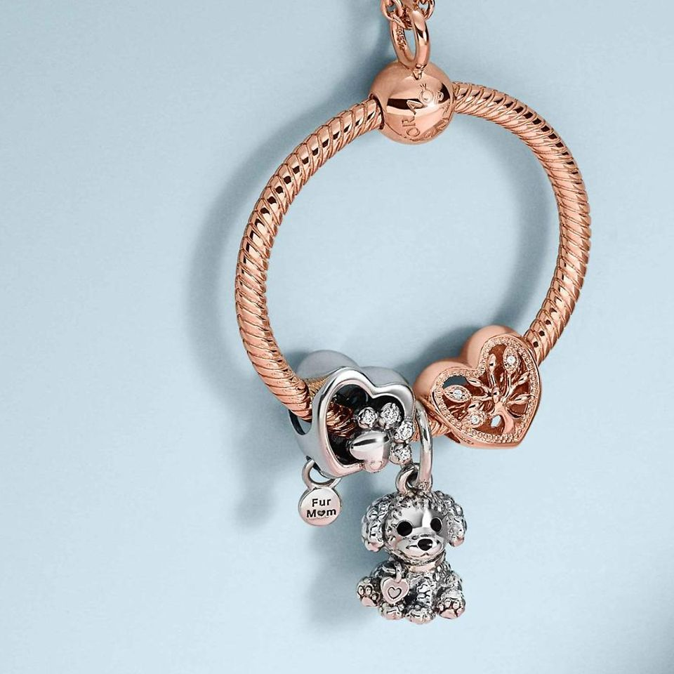 Wear family charms for a look inspired by those closest to you.