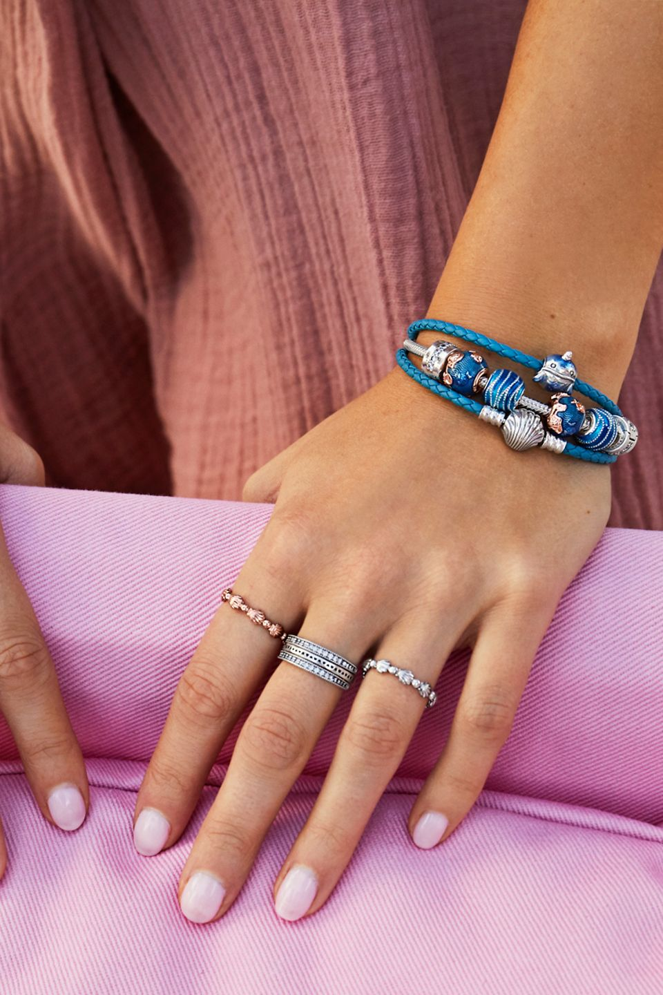 Stack your beach-themed charm bracelets and rings.