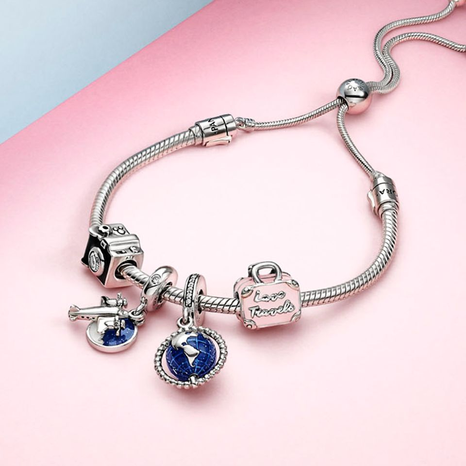 Travel-themed charms and jewellery for explorers and travellers